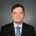 """Andreas Brüser schreibt seine Dissertation  """"Unternehmenskommunikation im Diskurs. Theoretischer Ansatz und Ableitungen für die Konzeption"""" berufsbegleitend bei komm.passion"""